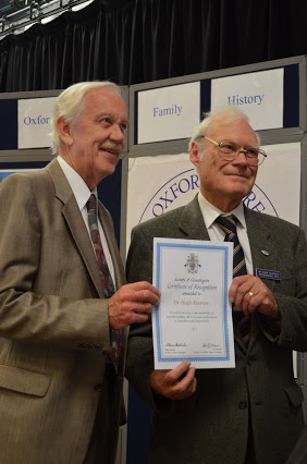 Colin Chapman presenting certificate of recognition to Hugh Kearsey for his work