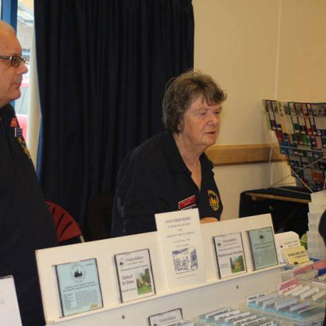 John Cramer, Pat Ford and Angela Wood at the CD & book stall