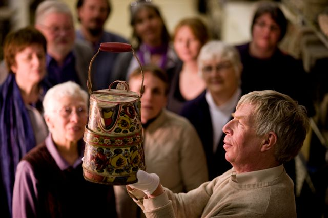 Man holding up a jug to be admired by audience