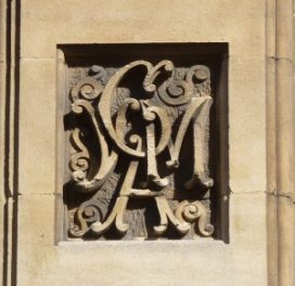 Carving on YMCA at George Street Oxford of the letters Y,M,C,A